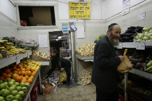 A Religious Jewish men shops for vegetables. Photo by Miriam Alster/FLASh90