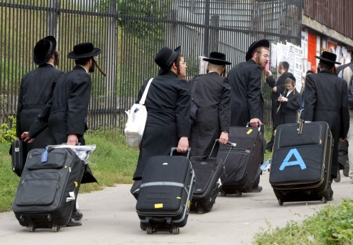 FILE - A group of ultra-orthodox hasid Jews carry their luggage as they arrive to a prayer at the grave of Rabin Nachman, founder of Bratslav Hasidism, in Uman, a small Ukrainian town some 200 km from Kiev, 06 September 2002.  EPA