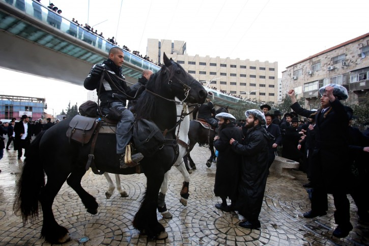 Hundreds of Ultra orthodox Jewish clash with Israeli police during a protest in Jerusalem on February 06, 2014, following the arrest of a haredi draft-dodger and against  a bill intended to enforce the haredi enlistment into the IDF (Israel Defense Force). Photo by Yonatan Sindel/Flash90