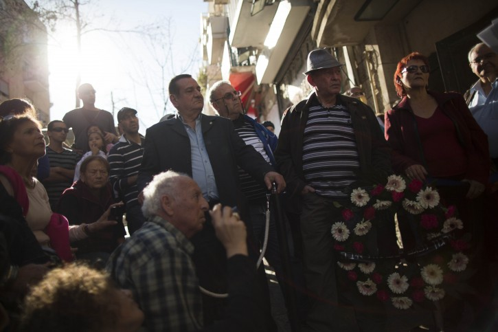 Israelis attend a memorial ceremony for the victims of the 1948 Ben Yehuda Street bombing in Jerusalem on February 20, 2014. Photo by Yonatan Sindel/Flash90