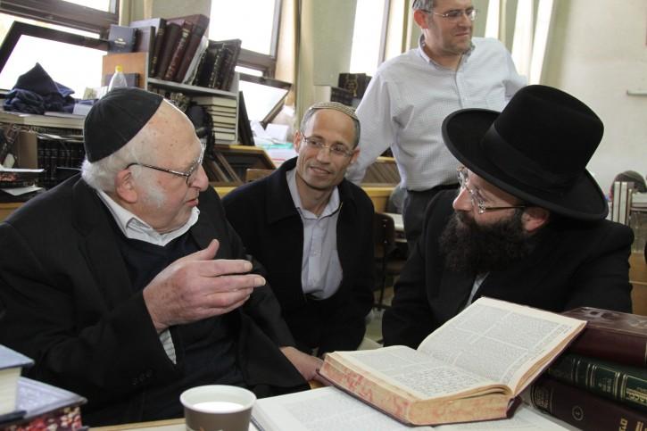 FILE - The Western wall's rabbi Shmuel Rabinovitz (R) meets with rabbi Aharon Lichtenstein (L) and Chairman of the Gush Etzion local council David Pearl (C) at the Har Etzion yeshiva in Alon Shvut. February 23, 2014. Photo by Gershon Elinson/Flash90