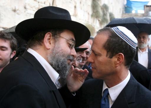 File photo Nir Barkat (R), Mayor of Jerusalem, listens to an unidentified Rabbi. EPA/YOSSI ZAMIR