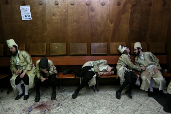File: Jewish men during Purim holiday in Mea Shearim neighborhood of Jerusalem, Israel, 25 February 2013.  EPA/ABIR SULTAN
