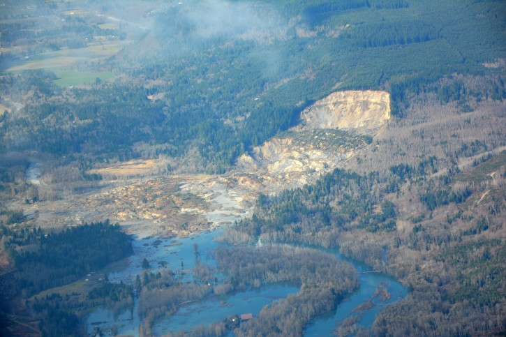 Handout image released by the Washington State Department of Transportation on 24 March 2014 showing the scene of a mudslide which destroyed several homes and killed at least eight people in Oso, Washington, USA, 23 March 2014.  EPA/WASHINGTON STATE DEPARTMENT OF TRANSPORTATION / HANDOUT