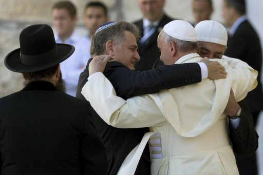 Pope Francis (2-R) embraces his friends from Argentina, Rabbi Abraham Skorka (2-L) and Argentine Muslim leader Omar Abboud (R) as the Rabbi of the Western Wall Shmuel Rabinovitz looks on (L), after the Pope prayed and placed a note into the Wall, Judaism's holiest site, in Jerusalem, Israel, 26 May 2014. EPA