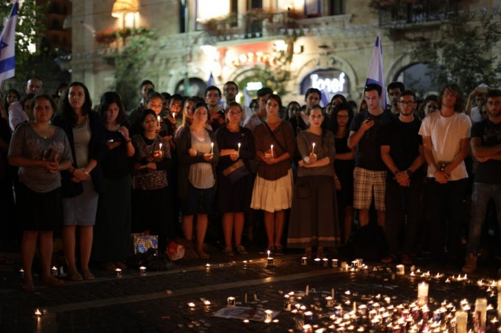 Israelis light candles at Rechov Yaffo in Jerusalem on June 30, 2014 in memory of the young Jewish teenagers Eyal Yifrach, Naftali Fraenkel and Gilad Sha'ar who were abducted on June 12.