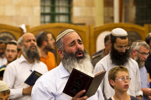 FILE - Jewish men take part in a prayer calling for the return of three missing teenagers, at the Tomb of the Patriarchs in the West Bank city of Hebron June 18, 2014.  Reuters