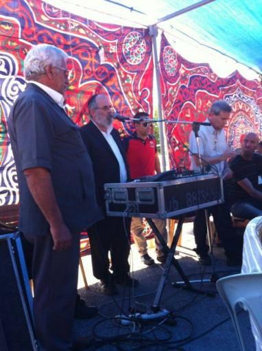 Rav David Bigman the Rosh HaYeshiva at Yeshivat Ma'ale Gilboa at the mourners tent of the Khdeir family