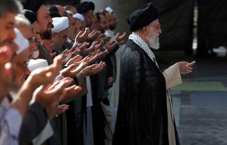 Iranian Supreme leader Ayatollah Khamenei (R) leading the Eid Al-Fitr-prayers marking the end of the fasting month of Ramadan, in Tehran, Iran, 29 July 2014.  EPA/IRAN SUPREME LEADER OFFICIAL WEBSITE  HANDOUT