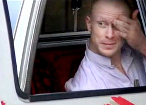 FILE - Sgt. Bowe Bergdahl, sits in a vehicle guarded by the Taliban in eastern Afghanistan.  (AP Photo/Voice Of Jihad Website via AP video, File)