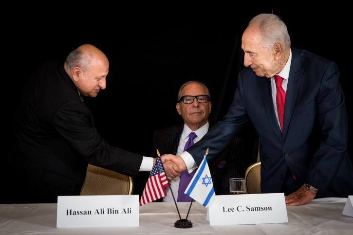 International Chairman Hassan Ali Bin Ali congratulating with President Peres, center photo is Lee Samson.