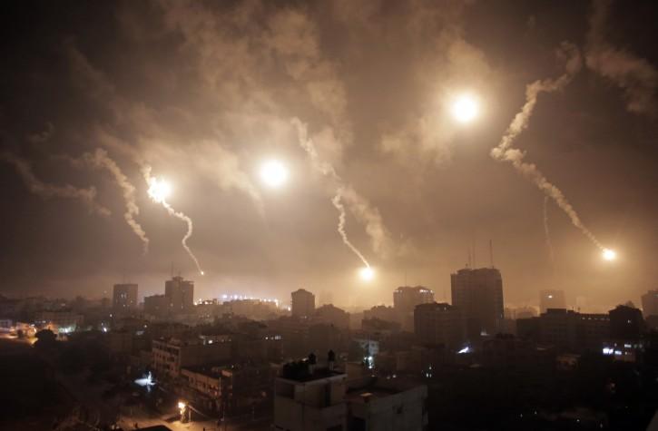 Israeli forces' flares light up the night sky of Gaza City on early Tuesday, July 29, 2014. (AP Photo/Khalil Hamra)