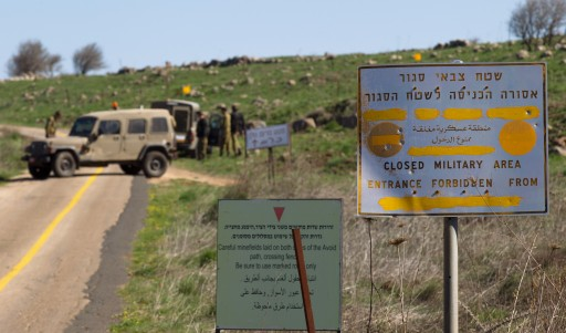 FILE -  Israel soldiers block a road that leads to  a Military base near the Israeli-Syrian border in the center of the Golan Heights, 05 March 2014. EPA