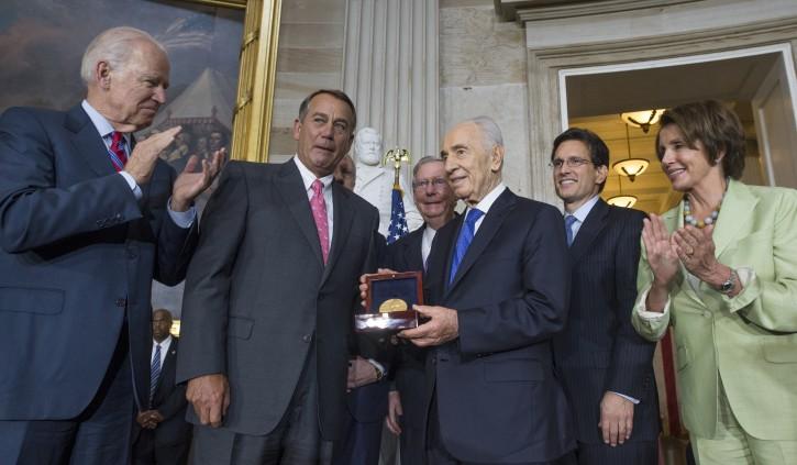 President of Israel Shimon Peres (3-R) is awarded the Congressional Gold Medal, beside US Vice President Joe Biden (L), Speaker of the House Republican John Boehner (2-L), Senate Minority Leader Republican Mitch McConnell (4-R), House Majority Leader Republican Eric Cantor (2-R) and House Minority Leader Democrat Nancy Pelosi (R), at the US Capitol in Washington DC, USA, 26 June 2014.  EPA/MICHAEL REYNOLDS
