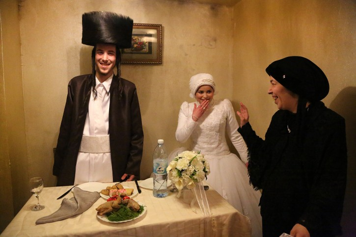 From over 18,000 photos submitted to National Geographic Traveler's 2014 photo contest, this image taken Feb. 18, 2014, by Polish photographer Agnieska Traczewska Of Aron and Rivkah Krauss after the Cupah, came in Second place.