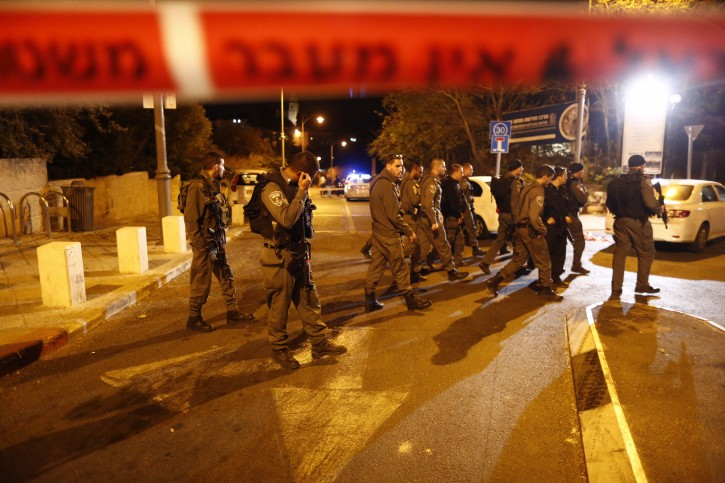 Israeli Police block the area where the Temple Mount Movement Leader, Yehuda Glik, was shot by a drive-by motorist, near the Pa'amon Park in Jerusalem, October 29, 2014. Glik leads a movement which strives to bring the Temple Mount to Jewish hands. Photo by Yonatan Sindel/Flash90