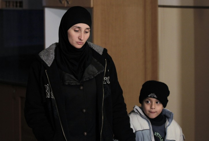 Nadia Abu Jamal, widow of Ghassan Abu Jamal who carried out a deadly attack on a Jerusalem synagogue, holds her sons hand in their house in the east Jerusalem neighbourhood of Jabal Mukaber on November 26, 2014, which Israel ordered to be destroyed. (Photo credit should read AHMAD GHARABLI/AFP/Getty Images)