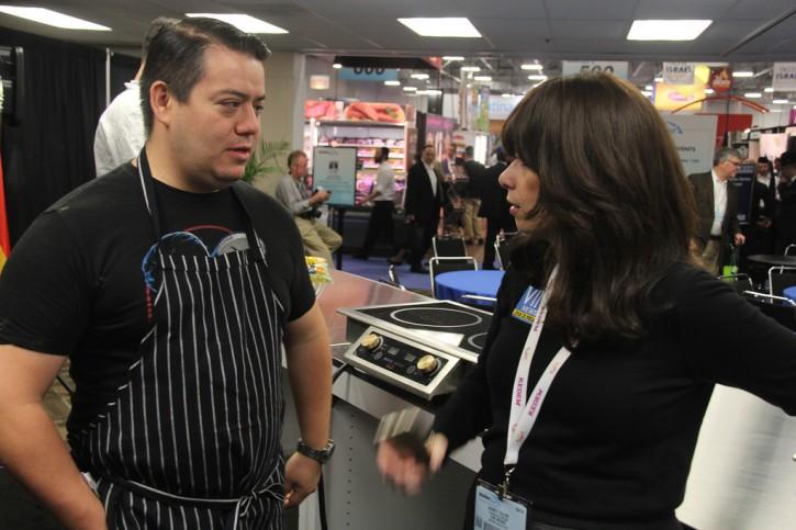 L-R Chef Katsuji Tanabe, of Los Angeles' Mexikosher restaurant speaking to VIN news reporter Sandy Eller, at Kosherfest 2014 on Nov. 11, 2014. (Shimon Gifter/VINnews.com)