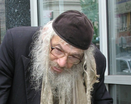 FILE - R Mendel Weiss, Reb Mendel was Known for his many layers of coats packed with papers and lived mostly on the streets as a homeless man in Williamsburg, Borough Park, and Flatbush, until a few years ago was placed in Palm Gardens in Flatbush, he passed away Sept. 30, 2014 (Dee Voch)