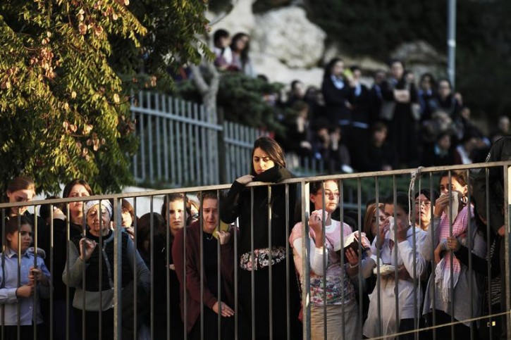 Israeli Ultra-Orthodox Jewish women and girls mourn during the funeral of Aryeh Kopinsky, Calman Levine and Avraham Shmuel Goldberg in Jerusalem November 18, 2014.  Reuters