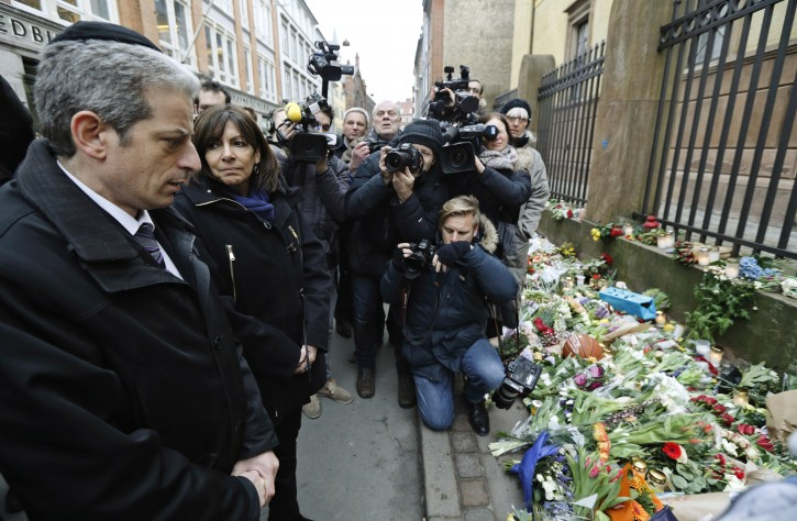 French Chief Rabbi Moise Lewin, left and Paris Mayor Anne Hidalgo visit the Synagogue in Copenhagen, during a visit to the Synagogue in Copenhagen, Monday, Feb. 16, 2015, after the attacks at the weekend. The slain gunman suspected in the deadly Copenhagen attacks was a 22-year-old with a history of violence and Danish authorities say he may have been inspired by Islamic terrorists — and possibly the Charlie Hebdo massacre in Paris. (AP Photo/Polfoto, Jens Dresling)
