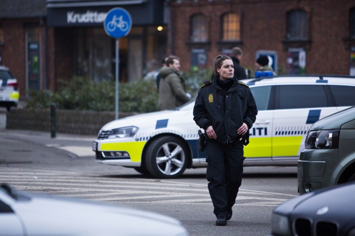 """A security officer patrols outside a venue after shots were fired where an event titled """"Art, blasphemy and the freedom of expression"""" was being held in Copenhagen, Saturday, Feb. 14, 2015.  AP"""