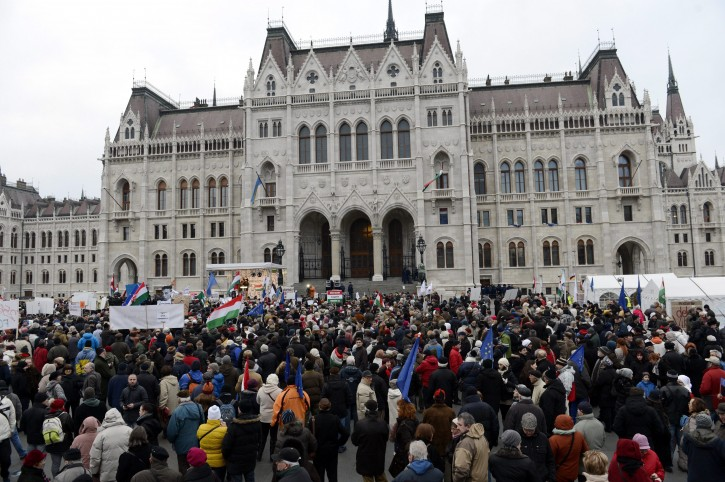 Demonstrators gather   in front of the Hungarian Parliament building during an anti-goverment demonstration  in Budapest, Hungary, Sunday, Feb. 1, 2015.   AP