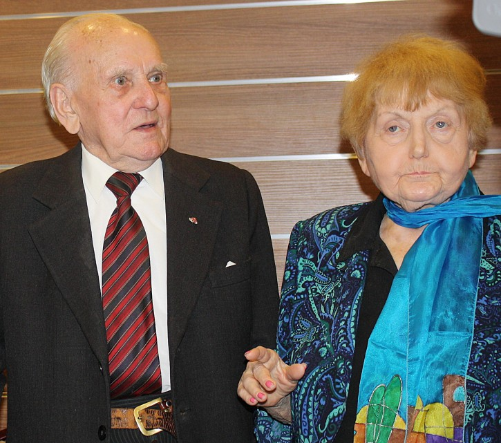 """In this Jan. 29 2015 picture Jozef Paczynski,left, 95, a former Auschwitz prisoner who was the barber to camp commandant Rudolf Hoess, stands next to Eva Mozes Kor, 81, a Jewish survivor of experiments by the sadistic German doctor Josef Mengele, in Krakow, Poland.  Paczynski spoke to a group about his experiences cutting Hoess' hair for four years. He said he has been asked over and over why he didn't use his sharp instruments to slit the throat of the mass murderer. """"I thought about it,"""" Paczynski said. """"But when I realized what the consequences would be I simply could not do it."""".  (AP Photo/Alexandra Fletcher)"""