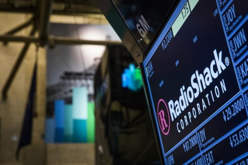 FILE - The ticker for RadioShack Corp. is seen at the post where it's traded just after the opening bell on the floor of the New York Stock Exchange March 4, 2014.  Reuters