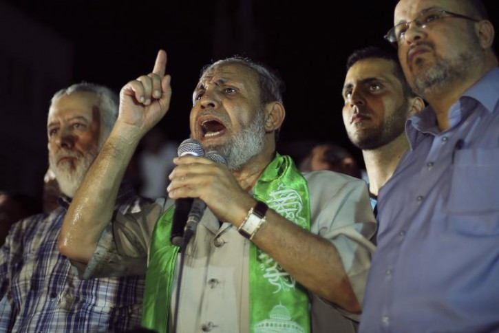 FILE - Senior Hamas leader Mahmoud Al-Zahar speaks during a rally by Palestinians celebrating what they said was a victory over Israel, following a ceasefire in Gaza City August 26, 2014. Reuters