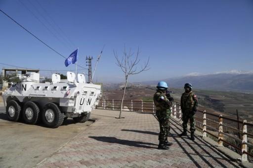 U.N. peacekeepers of the United Nations Interim Force in Lebanon (UNIFIL) patrol the Lebanese-Israeli border in Adaisseh village, southern Lebanon January 29, 2015. REUTERS