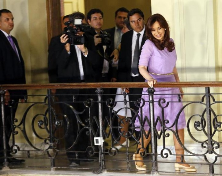 Argentina's President Cristina Fernandez de Kirchner looks at her supporters after making an announcement on new subsidies and benefits for school renovation works, at the Casa Rosada government house in Buenos Aires February 11, 2015.  REUTERS/Enrique Marcarian