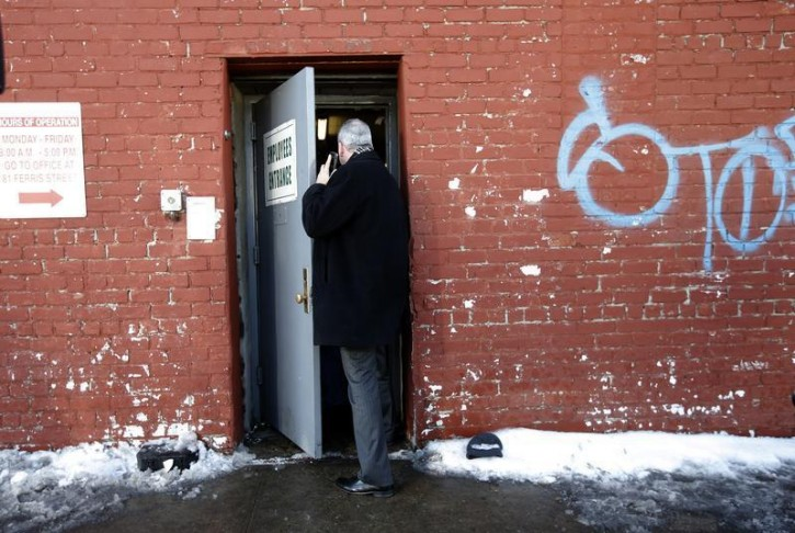 A law enforcement official enters 175-177 Dikeman Street which houses Dell's Maraschino Cherries company in the Brooklyn borough of New York City February 25, 2015. The Brooklyn maraschino cherry processor is under investigation after hidden marijuana plants were discovered in the family-owned business and its owner committed suicide while authorities were searching the premises during an unrelated raid, prosecutors said on Wednesday.   REUTERS/Mike Segar