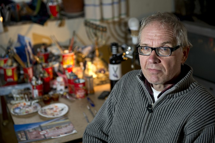 FILE - In this Jan. 3, 2012 file photo, Swedish artist Lars Vilks poses for a photograph in Nyhamnslage, Sweden. Shots were fired Saturday, Feb. 14, 2015 at a cafe in Copenhagen that was hosting a freedom of speech event organized by Swedish artist Lars Vilks, who has faced numerous threats for caricaturing the Prophet Muhammad. (AP Photo/Bjorn Lindgren, File)