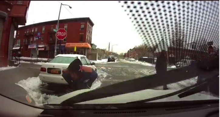 Image grake from Shaya Jungreis dashcam shows two black men approaching the car from either side on Feb 3, 2015