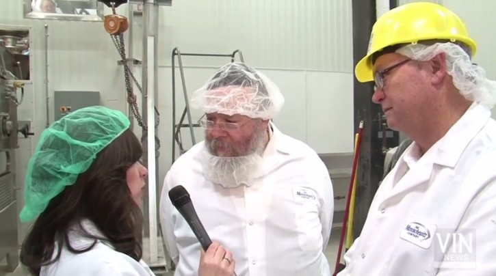 FILE - (L-R) Associate editor of VIN news Sandy Eller, Rabbi Yaakov Horowitz Chief Rabbi at Manischewitz plant, Randell Copeland VP of operations at Manischewitz, on Mar. 11, 2015