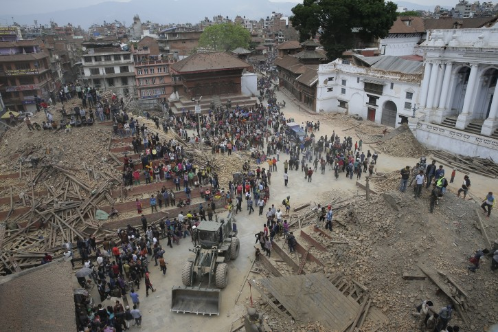 People search for survivors under the rubble of collapsed buildings in Kathmandu Durbar Square, after an earthquake caused serious damage in Kathmandu, Nepal, 25 April 2015. EPA