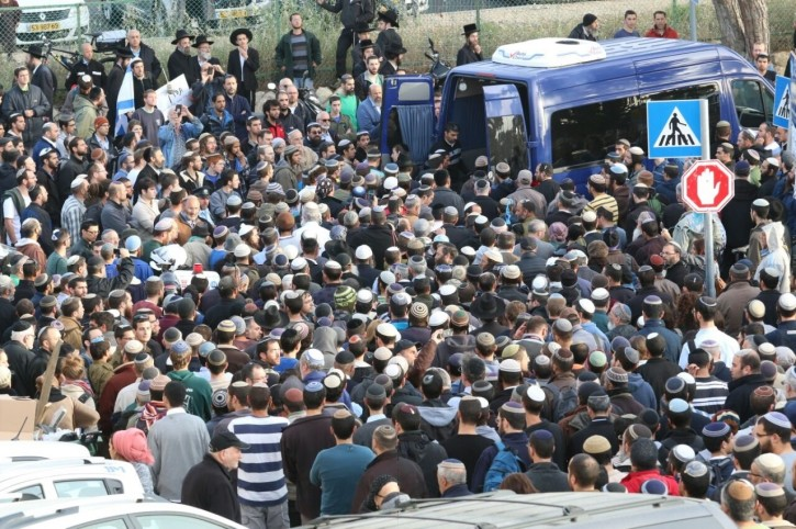 The funeral of Shalom Shreki, the 25-year-old man killed in what police believe may be a car slamming terror attack in the French Hill neighborhood of Jerusalem on the eve of Holocaust Remembrance Day. The funeral took place on Thursday evening, April 16 in Jerusalem's Har Hamenuchot Cemetery. (Hillel Maeir, Tazpit News Agency)