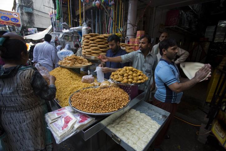 Pakistani customers buy foodstuff ahead of Ramadan in Rawalpindi, Peshawar, Pakistan, Tuesday, June 16, 2015.  Muslims throughout the world mark the month of Ramadan, the holiest month in the Islamic calendar, with dawn to dusk fasting. (AP Photo/B.K. Bangash)
