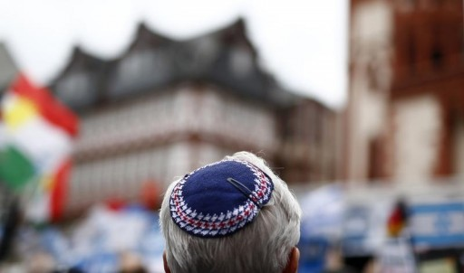 FILE - A protester wearing a kippah attends a rally against anti-Semitism in Frankfurt August 31, 2014.REUTERS
