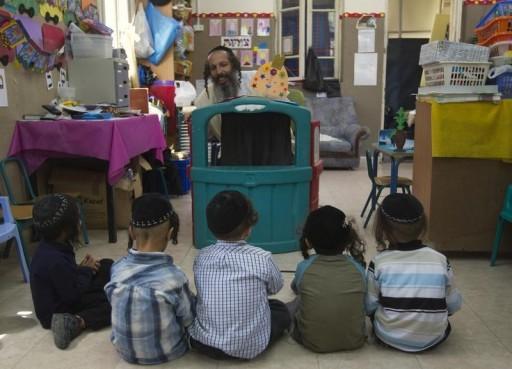 FILE - Jewish boys listen to their teacher. REUTERS/Ronen Zvulun/FILE