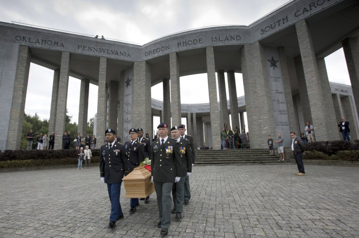 Soldiers of the U.S. and Belgian Army carry the coffin of Augusta Chiwy during a memorial service at the Mardasson Memorial in Bastogne, Belgium on Saturday, Aug. 29, 2015. Augusta Chiwy, 94, a Belgian nurse who helped save hundreds of American soldiers during the Battle of the Bulge at the end of World War II, was buried Saturday near where thousands of Allied troops fell. (AP Photo/Virginia Mayo)