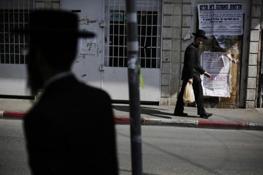 FILE - Jewish men walk in Jerusalem's Mea Shearim neighbourhood September 7, 2014. REUTERS