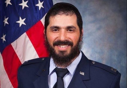 Rabbi Elie Estrin celebrates a new landmark a year-and-a-half after becoming the US Air Force's first bearded chaplain following the lifting of a ban on displays of religious belief.