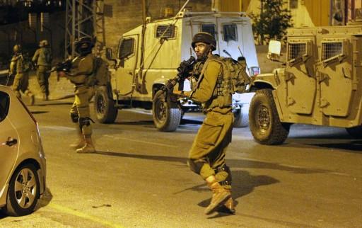 FILE - Israeli soldiers patrol in the West Bank city of Hebron, early 30 June 2014. EPA