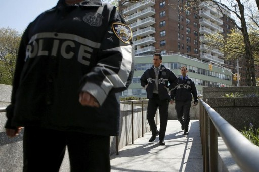 FILE - NYPD officers in Queens in New York May 3, 2015.  Reuters