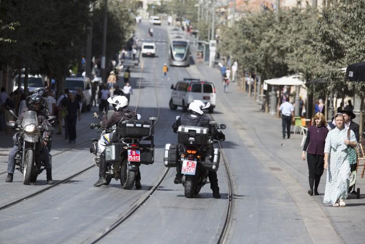 Israeli police patrol central Jerusalem's Jaffa Road where the Light Rail trolley runs  15 October 2015.  EPA