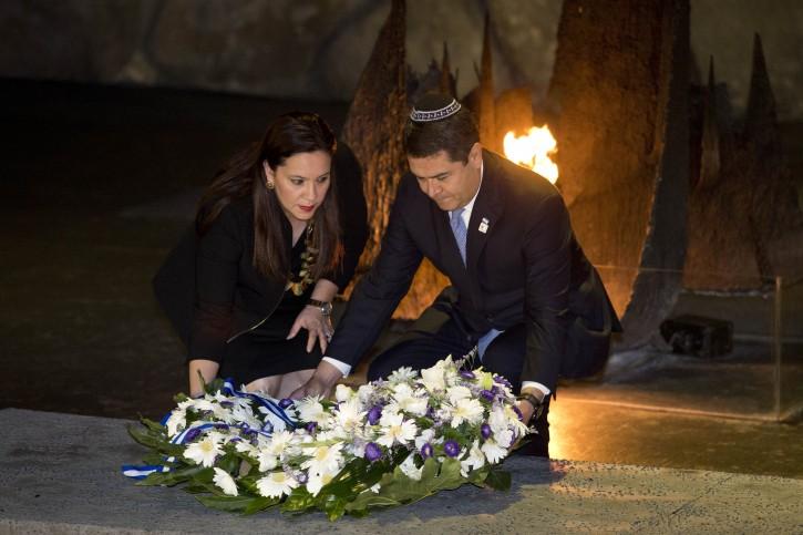 President of the Republic of Honduras  Juan Orlando Hernandez Alvarado (R) and his wife Ana Garcia lay a wreath in the Hall of Remembrances at the Yad Vashem Holocaust Memorial Museum in Jerusalem, Israel, 29 October 2015.  EPA/ABIR SULTAN