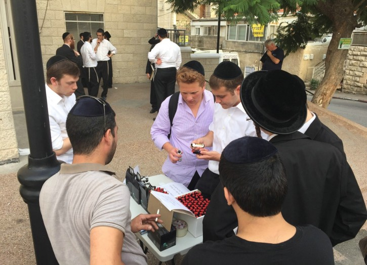 Yeshiva students purchase pepper spray outside the MIR Yeshiva in Jerusalem, October 12, 2015.