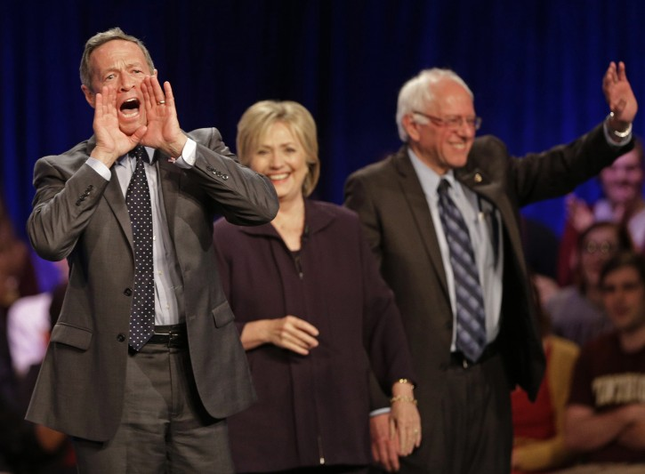 Democratic presidential candidate former Maryland Gov. Martin O'Malley, left, shouts to supporters as Democratic presidential candidates Hillary Rodham Clinton, center, and Sen. Bernie Sanders, I-Vt, right, waves to supporters after a democratic presidential candidate forum at Winthrop University in Rock Hill, S.C., Friday, Nov. 6, 2015. (AP Photo/Chuck Burton)